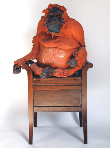 Orangutan sat in chair
